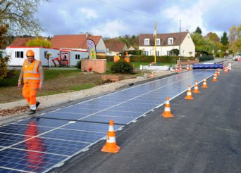 Solar panels, produced by Colas SA's Wattway unit, owned by Bouygues SA, are laid onto a road in this undated handout photo released to the media on Wednesday, Nov. 23, 2016. A subsidiary of Bouygues SA has designed rugged solar panels, capable of withstand the weight of an 18-wheeler truck, that theyÕre now building into road surfaces. Source: Wattway